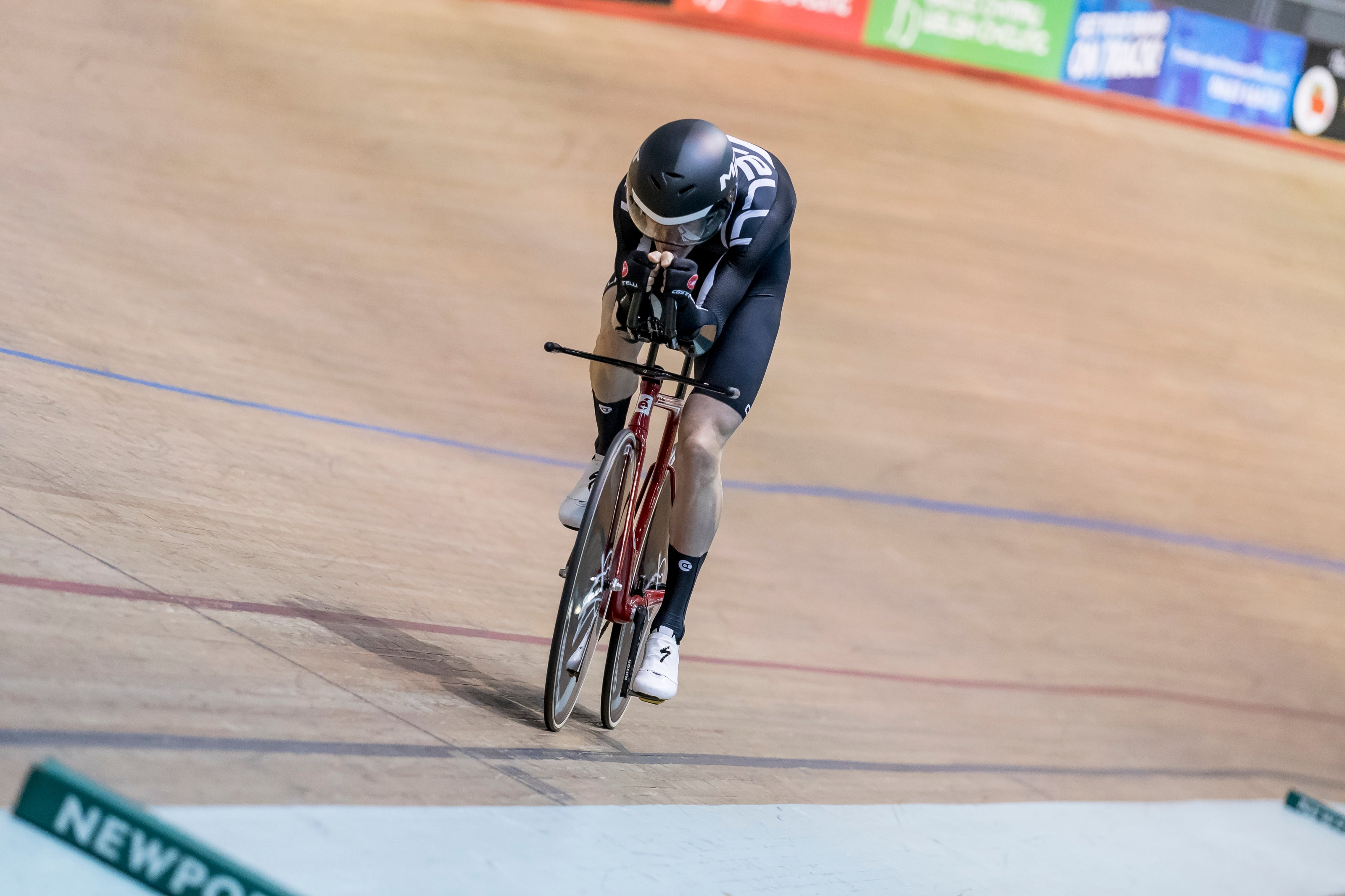 Trying to keep tucked up and as aerodynamic as possible. Photo credit to Andy Whitehouse.