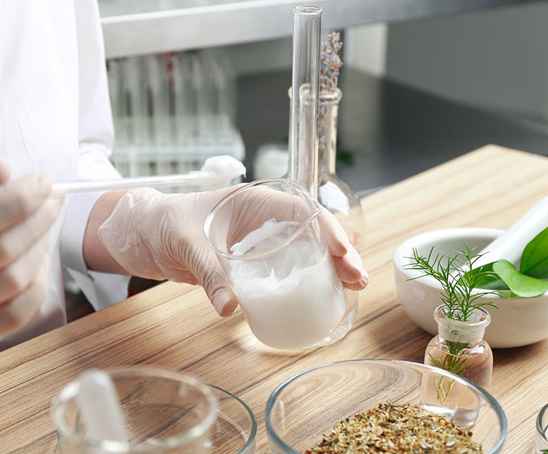 Woman testing ingredients for a skincare formula