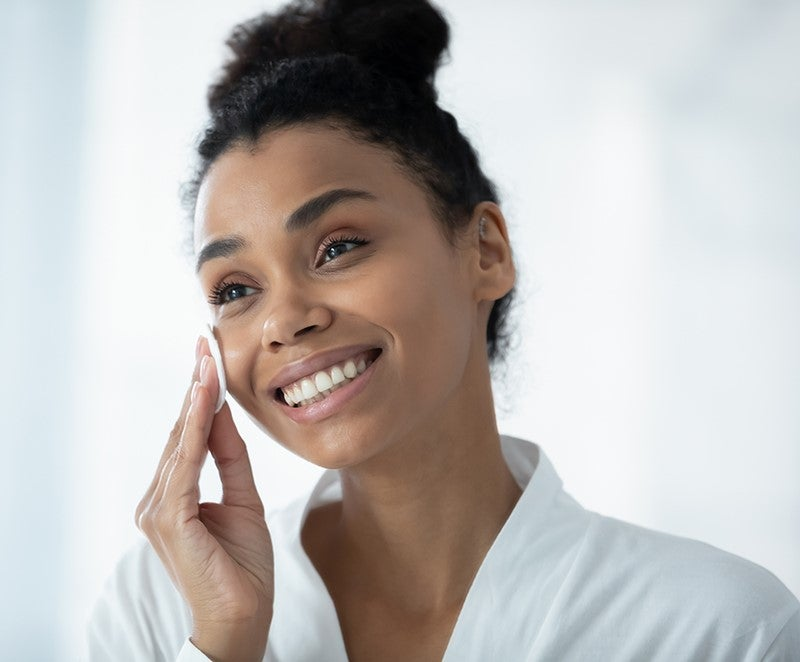 Woman practicing a skin care routine.