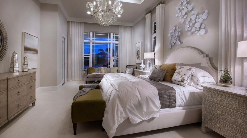 The Master Bedroom of The Montclair by STOCK Signature Homes at The Lake Club in Lakewood Ranch Florida