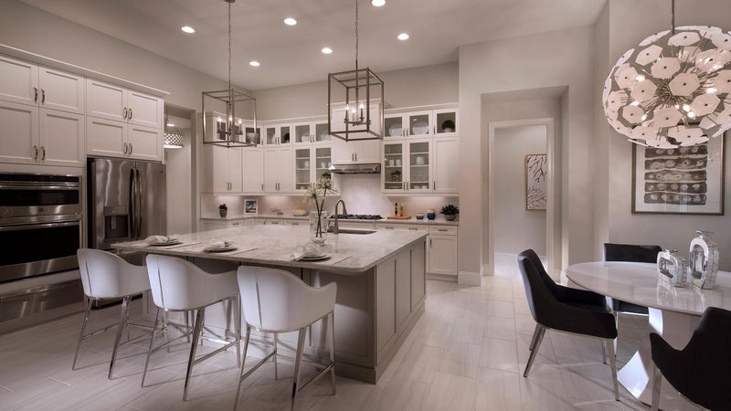 The Kitchen of The Marigold by STOCK Signature Homes at The Isles of Collier Preserve in Naples Florida