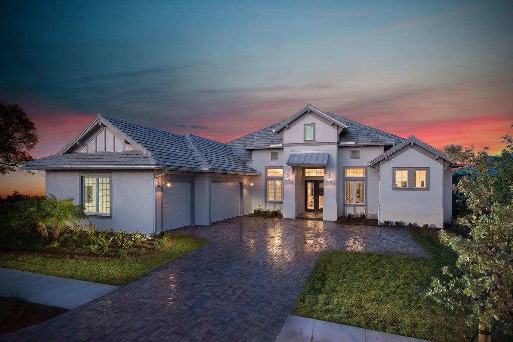 The Marigold by STOCK Signature Homes at The Isles of Collier Preserve in Naples Florida (Elevation E)