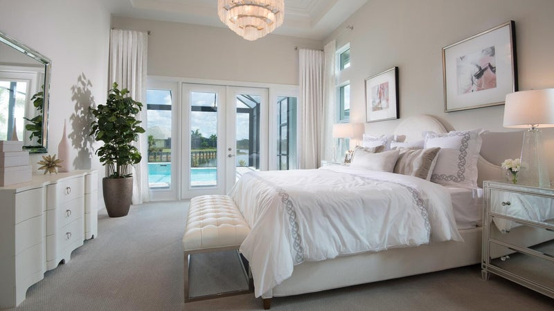 The Master Bedroom of The Marigold by STOCK Signature Homes at The Isles of Collier Preserve in Naples Florida