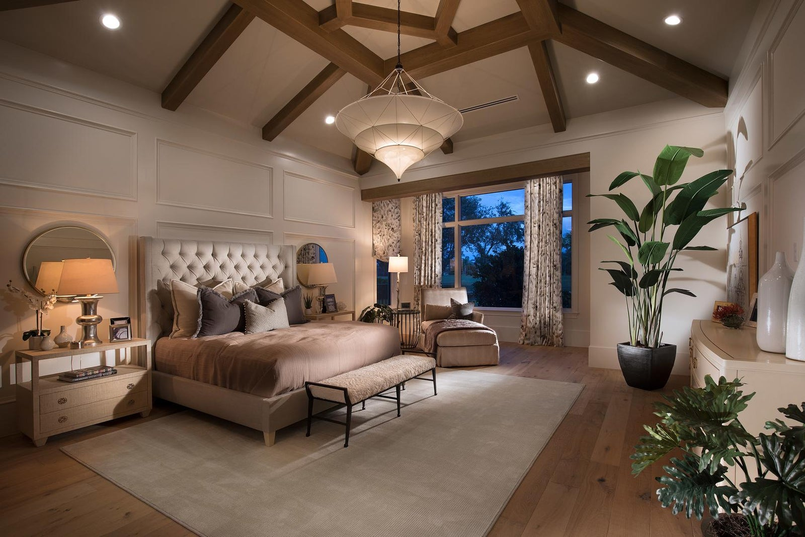 The Master Bedroom of the Calista by STOCK Custom Homes at Quail West in Naples Florida