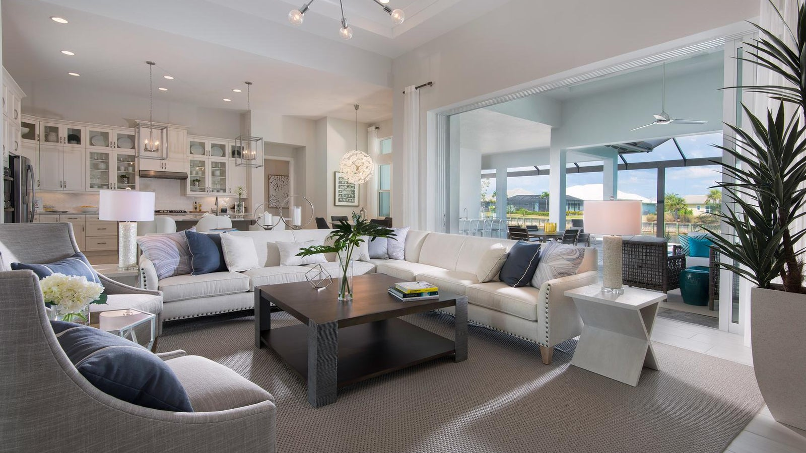 The Great Room of The Marigold by STOCK Signature Homes at The Isles of Collier Preserve in Naples Florida