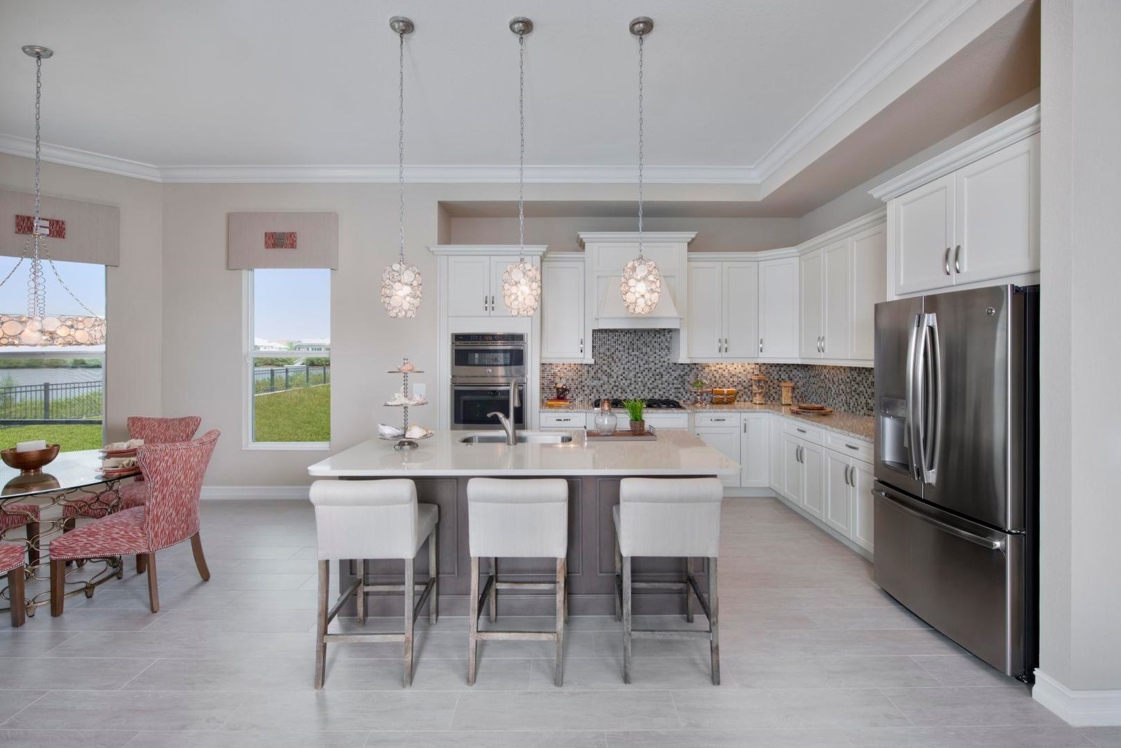 The Kitchen of The Ruffino by STOCK Signature Homes at Hidden Harbor in Fort Myers Florida