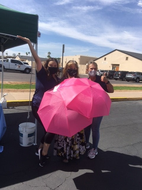 Pink umbrellas indicate where older adults can get a Lyft