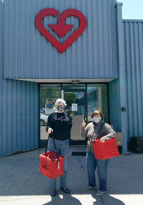 2.VAC Sycamore Illinois site with Meals on Wheels Volunteers carrying meal bags.