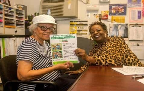 Dolores, one of the clients served by Watts Labor Community Action Committee, shares a smile with her counselor.