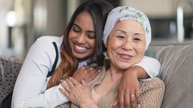 Millenial caregiver with older Asian woman
