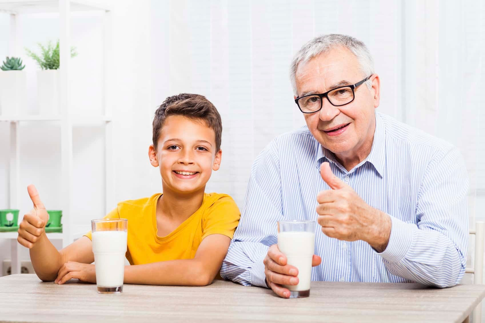 grandfather and grandson with milk