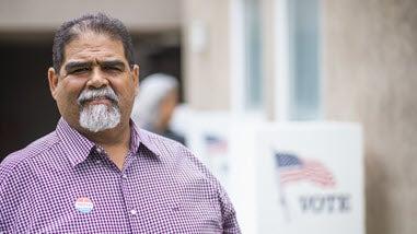 Older Hispanic man at polling location
