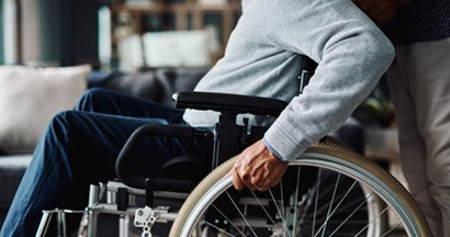 Man moving in his wheelchair at home during the day