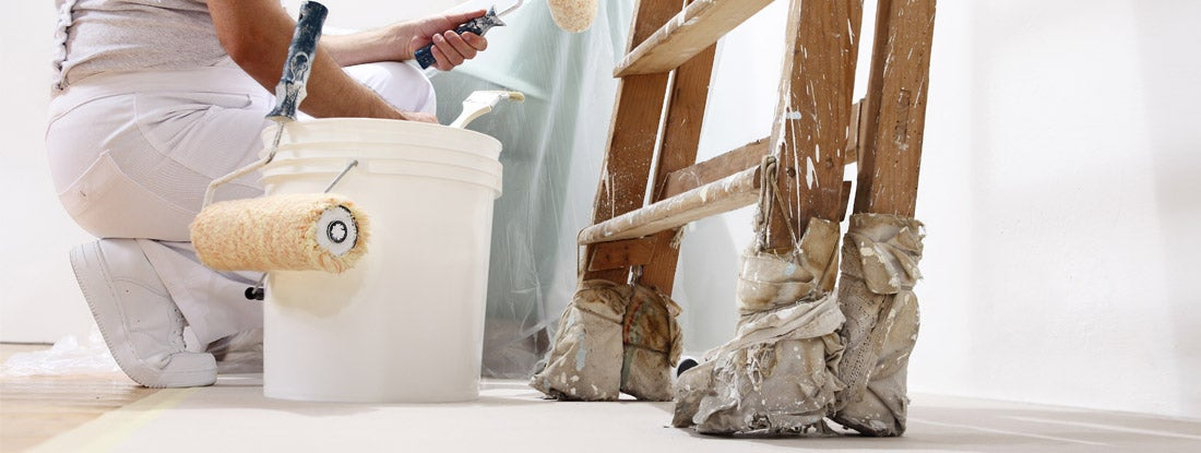 painter painting a white wall