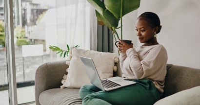 Woman having coffee and shopping online for insurance. Which is better, an independent agent or an online bot?