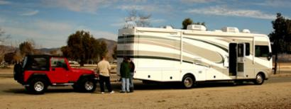 An RV with its towable car.