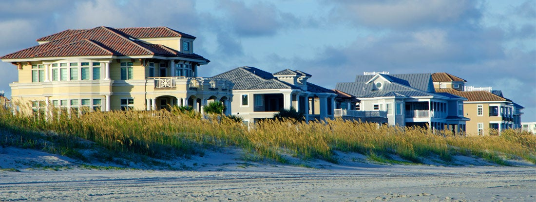 A row oceanfront beach houses.