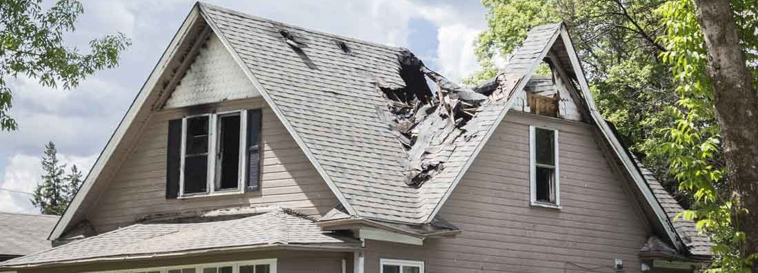 roof of a house burned and caved in