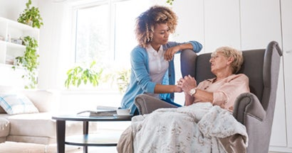 Home nurse taking care of an eldery lady