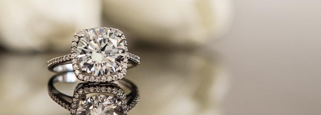 White gold wedding ring on flower background