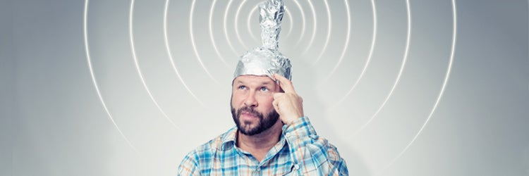 Cousin Eddie in a cap of aluminum foil sending signals