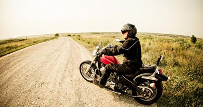 man on motorcycle on a dirt road