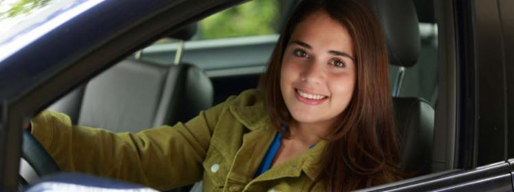 Teen girl in new car