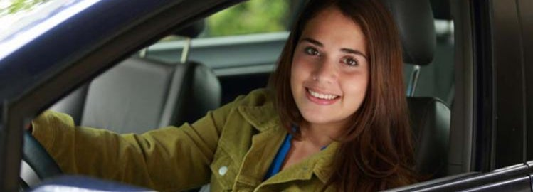 Teen girl in new car