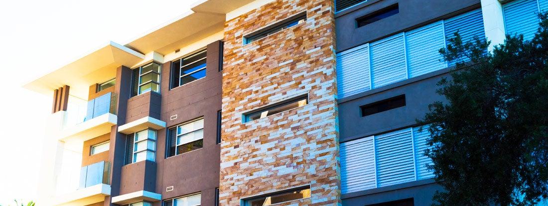 Modern apartment building in dusk sunlight