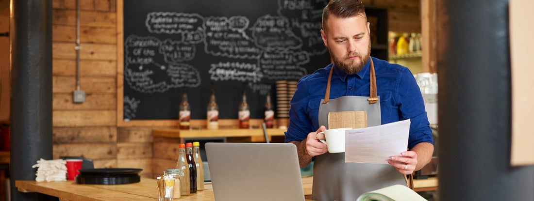 restaurant owner reviewing business insurance