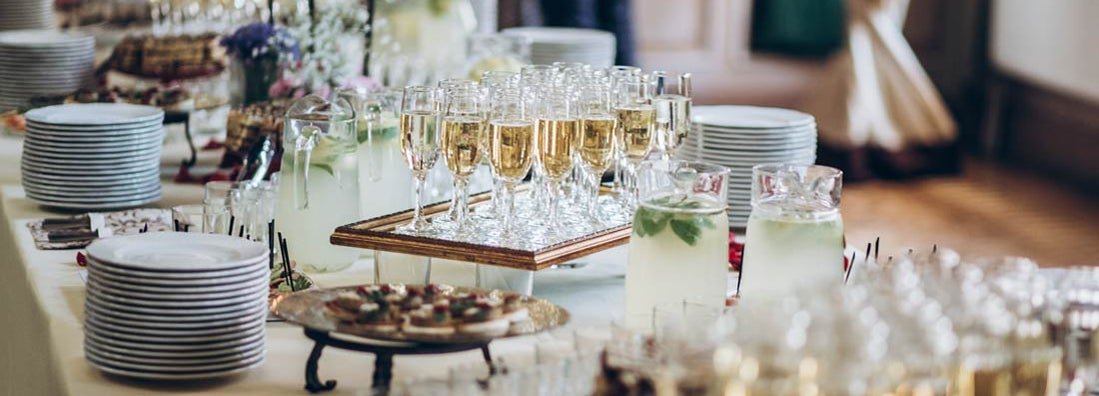 stylish champagne glasses and food appetizers set up by catering business