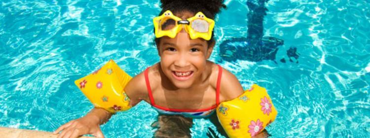 Little girl practicing pool safty