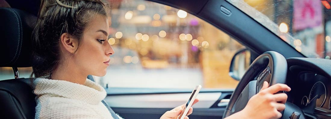Young girl is texting in the traffic jam - driving laws in New York