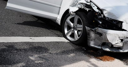 A white car just involved in a car crash at an intersection of a city street. What happens if you don't file a claim after a car accident?