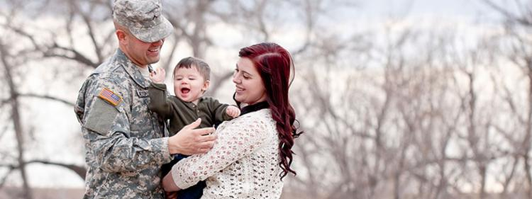 Man on leave from the army with his wife and young son.