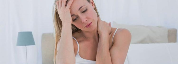 Woman in bed with neck pain