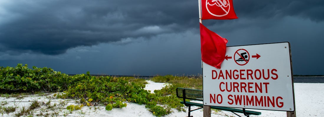 Tropical storm clouds gather off the Florida coast. Find Florida hurricane insurance.