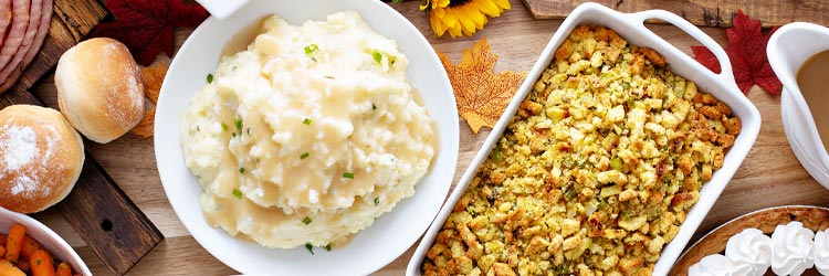 Thanksgiving table with mashed potatoes and stuffing