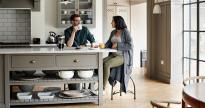 Young couple having breakfast together at new home