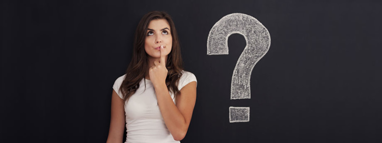 Woman wondering what questions to ask about buying a used car.