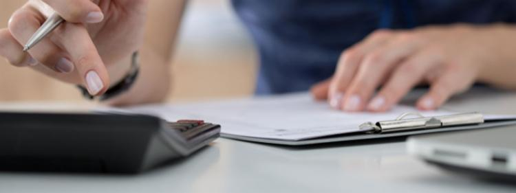 Woman calculating credit report