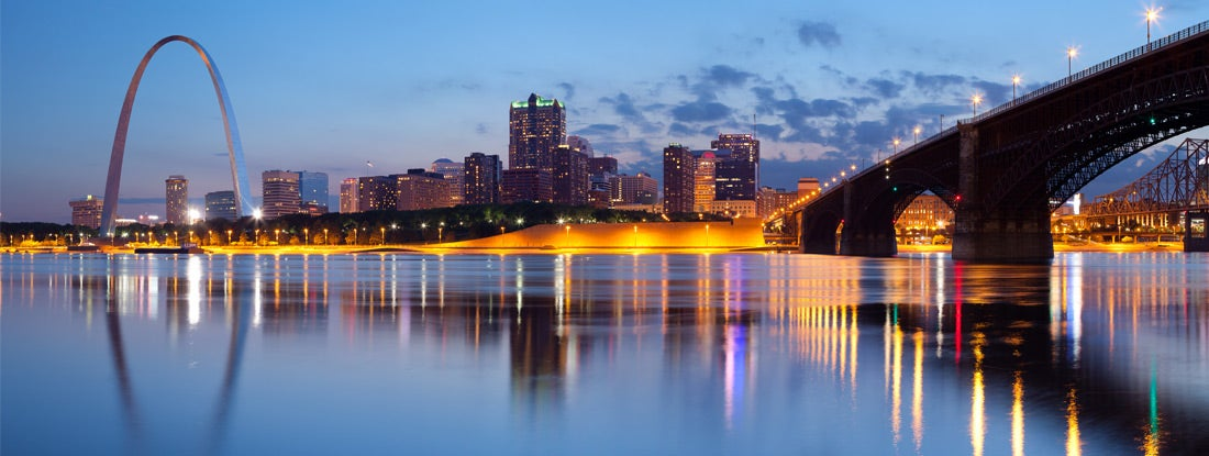 Panoramic image of St. Louis downtown with Gateway Arch at twilight