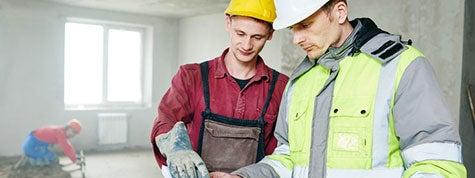 concrete contractors going over a plan