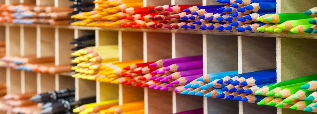 Multicolored pencils in art store closeup