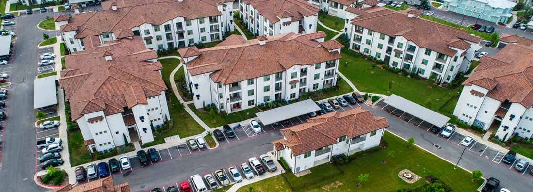 Aerial drone view above condo apartment buildings in Austin, Texas. Find Texas renters insurance.