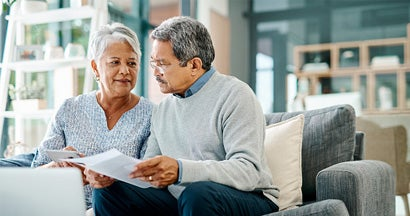 mature couple going through paperwork together at home