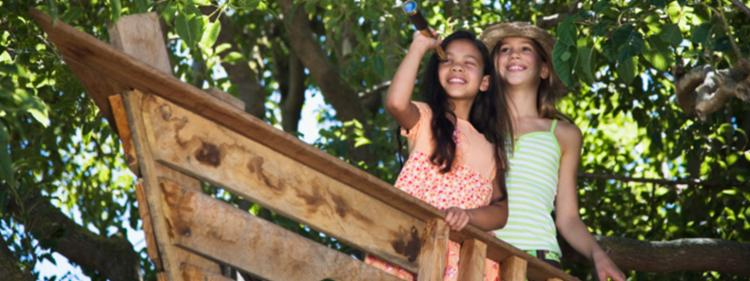 Girls sitting in a treehouse