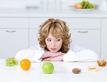 Woman trying to choose a healthy snack