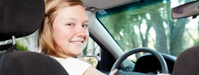 A young girl with a school driving permit