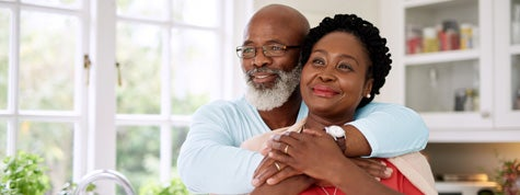 happy mature couple spending time together at home